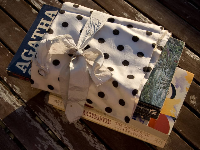 agatha christie novels wrapped in cloth and tied with a ribbon