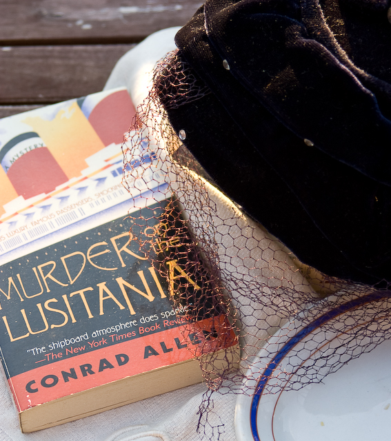 mystery novel and ladies hat